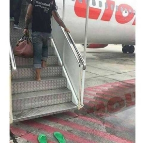 """Did This Really Happen? Caption This Photo Of A """"Well-Trained"""" Man Boarding A Plane"""
